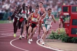 1996, Atlanta, Georgia, USA --- Algerian athlete Noureddine Morceli runs the last lap of the 1500 meters event at the Olympic Games, in which he won the gold medal. --- Image by © Mike King/CORBIS
